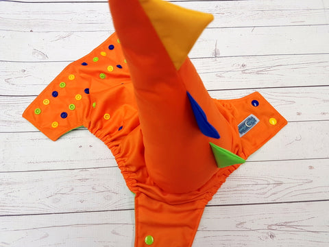 Orange (orange outer, spring green awj, apple, royal, marigold alternating snaps) Dino Tail<br>One Size Pocket Diaper<br>Instock and Ready to Ship