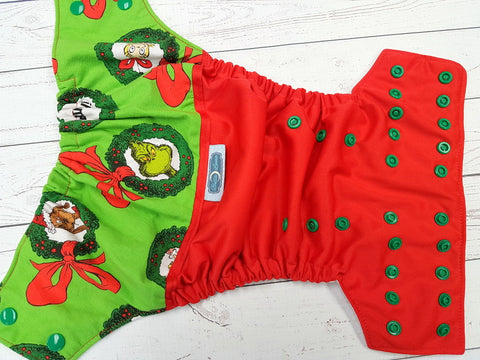 Mean One Wreathe (red outer, white awj, kelly snaps) <br>Wrap Around, One Size Pocket Diaper<br>Instock and Ready to Ship