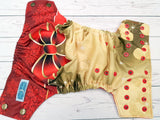 Tied up with a Bow (red awj, two toned snaps; bronze caps, red pieces) <br>Traditional, One Size Pocket Diaper<br>Instock and Ready to Ship