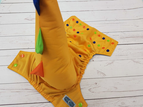 Marigold (orange, apple, royal alternating snaps) Dino Tail <br>One Size Pocket Diaper<br>Instock and Ready to Ship