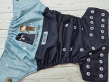 Little Whovian (navy outer, white inner, two toned snaps; bronze caps, light blue pieces) <br>Wrap Around, One Size Pocket Diaper<br>Instock and Ready to Ship