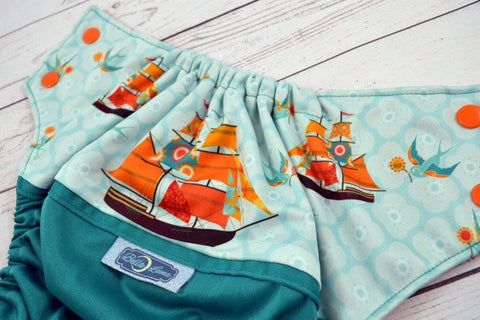 Vintage Jade Ships ( jade outer , two-toned snaps - seaspray caps / orange pieces ) <br>Wrap Around, One Size Pocket Diaper<br>Instock and Ready to Ship