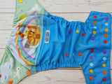 Noah's Arc Exclusive (aqua outer, citron awj, red, orange, marigold, seaspray, violet alternating snaps) <br>Wrap Around, One Size Pocket Diaper<br>Instock and Ready to Ship