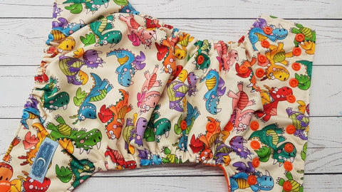 Colorful Dragons (orange awj & snaps) <br>Performance Knit Traditional, One Size Pocket Diaper<br>Instock and Ready to Ship
