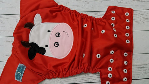 Moo Cow (red pul, white awj, two toned snaps; black caps, white pieces) <br>Embroidered, One Size Pocket Diaper<br>Instock and Ready to Ship