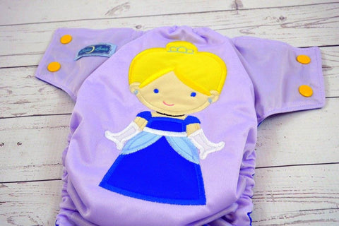 Cinder Girl ( lavender outer / two-toned snaps / marigold caps / royal pieces) <br>Embroidered, One Size Pocket Diaper<br>Instock and Ready to Ship