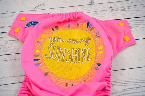 My Little Sunshine ( raspberry outer / marigold snaps ) <br>Embroidered, One Size Pocket Diaper<br>Instock and Ready to Ship
