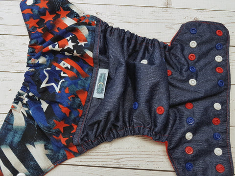 America's Pride (blue jean outer, red awj, red, white, blue alternating snaps) <br>Printed PUL Wrap Around, One Size Pocket Diaper<br>Instock and Ready to Ship