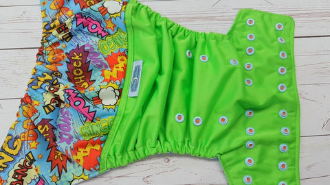 Shock! WOW! Bang! (spring green pul, light blue awj, two toned snaps; orange caps, light blue pieces) 6.1 <br>Printed PUL Wrap Around, One Size Pocket Diaper<br>Instock and Ready to Ship