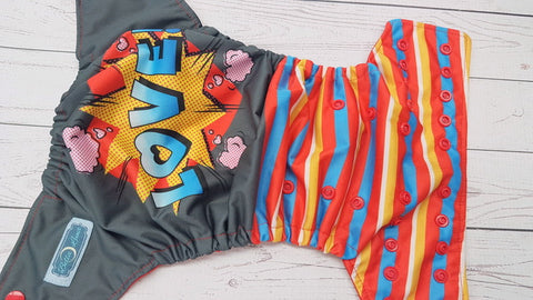 Comic Love (red awj & snaps) <br>Traditional, One Size Pocket Diaper<br>Instock and Ready to Ship
