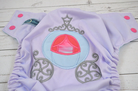 Princess Carriage  ( lavender outer , how pink caps - light blue pieces ) <br>Embroidered, One Size Pocket Diaper<br>Instock and Ready to Ship