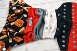 The Great Bambino (two-toned snaps- white caps / silver pieces)<br>PK Wrapped Crazy Scrappy, One Size Pocket Diaper<br>Instock and Ready to Ship