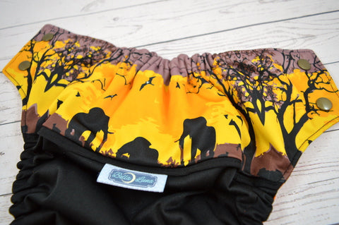Sunset Safari (black outer, bronze snaps) <br>Wrap Around, One Size Pocket Diaper<br>Instock and Ready to Ship
