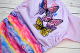 Watercolor Butterfly (Inner- Raspberry, Snaps- Medium Purple Caps, Light Pink Pieces)<br>Embroidered Half & Half, One Size Pocket Diaper<br>Instock and Ready to Ship