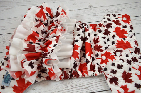 Oh Canada WITH RUFFLES  (white awj & snaps)<br>Traditional, One Size Pocket Diaper<br>Instock and Ready to Ship