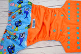 MINKY Just Keep Swimming (Outer- Orange, Inner & Snaps- Aqua)<br>Wrap Around, One Size Pocket Diaper<br>Instock and Ready to Ship