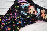 Drew's Splatter Painted Pony (printed pul outer, hot pink/medium purple/aqua/marigold/orange alternating) <br>Wrap Around, One Size Pocket Diaper<br>Instock and Ready to Ship