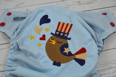 Patriotic Birdy USA ( light blue outer, red caps, navy pieces )<br>Embroidered, One Size Pocket Diaper<br>Instock and Ready to Ship
