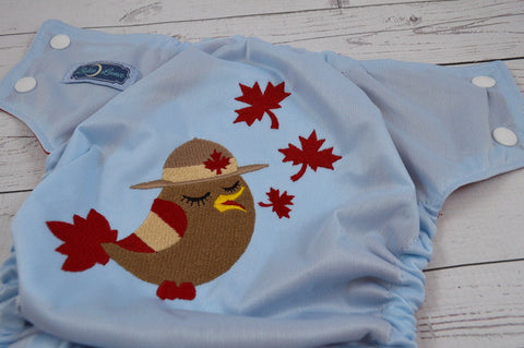 Patriotic Birdy Canada ( light blue outer, white caps, red pieces )<br>Embroidered, One Size Pocket Diaper<br>Instock and Ready to Ship