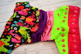 Little Tusker (two-toned snaps - apple capls / hot pink pieces)<br>Bella Bum Scrappy, One Size Pocket Diaper<br>Instock and Ready to Ship