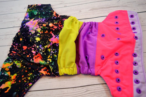 Art Attack (two-toned snaps - black caps / violet pieces)<br>Bella Bum Scrappy, One Size Pocket Diaper<br>Instock and Ready to Ship