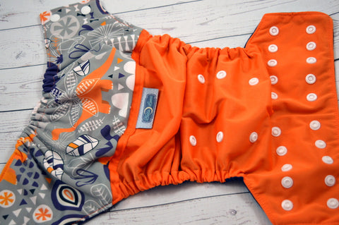 Orange Omeisaurus (orange outer, surprise snaps) <br>Wrap Around, One Size Pocket Diaper<br>Instock and Ready to Ship