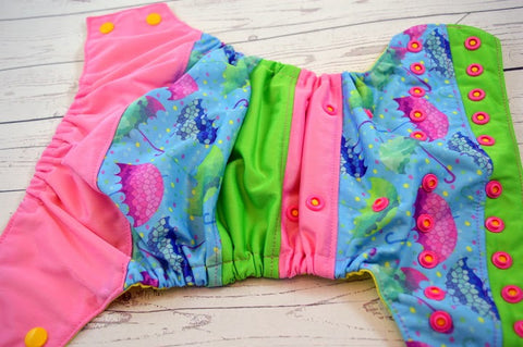 Singing in the Rain (two-toned snaps - marigold caps / hot pink pieces)<br>Boutique Scrappy, One Size Pocket Diaper<br>Instock and Ready to Ship