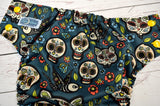 Gatos Calaveras (aqua awj, two toned snaps; marigold caps, aqua pieces) <br>Traditional, One Size Pocket Diaper<br>Instock and Ready to Ship