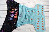 To the Moon & Back Exclusive (seaspray pul, orange awj, two toned snaps; violet caps, orange pieces) <br>Wrap Around, One Size Pocket Diaper<br>Instock and Ready to Ship