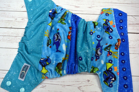 Deep Blue Sea Scrappy (seaspray awj, two toned snaps; seaspray caps, royal pieces)<br>ONE OF A KIND<br>One Size Pocket Diaper<br>Instock and Ready to Ship