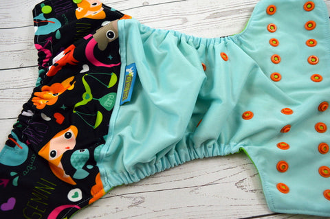 Zodiac Diaper ( seaspray outer - two-toned snaps -  apple caps / orange pieces)<br>Wrap Around, OS Pocket Diaper<br>Instock and Ready to Ship