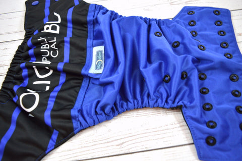 **SECONDS** Police Box PK Wrap Around (royal pul, black awj, two toned snaps; royal caps, black pieces)<br>One Size Pocket Diaper<br>Instock and Ready to Ship