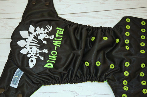 Dino-Mite (Outer- Black, Inner- Spring Green, Snaps- Two Toned; Black Caps, Apple Pieces) <br>Embroidered, One Size Pocket Diaper<br>Instock and Ready to Ship