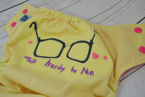 Talk Nerdy to Me Butter ( butter outer, two-toned snaps- hot pink caps / violet pieces)<br>Embroidered, One Size Pocket Diaper<br>Instock and Ready to Ship