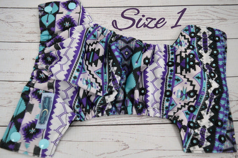 Newborn Purple Aztec (Inner- Black, Snaps- Two Toned; Seaspray Caps, Black Pieces)<br>Traditional Size One Pocket Diaper<br>Instock and Ready to Ship