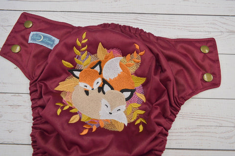Fox Cuddles (burgundy pul, butter awj, bronze snaps)<br>Embroidered, One Size Pocket Diaper<br>Instock and Ready to Ship