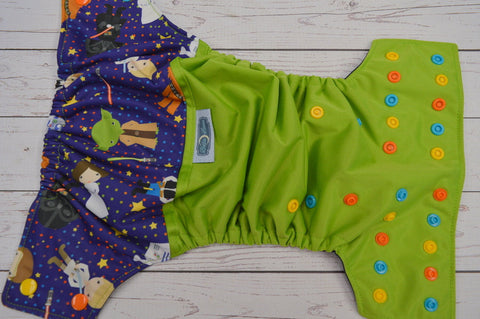 Master Trainer (ribbit pul, navy awj, aqua, orange, marigold alternating snaps)<br>Wrap Around, One Size Pocket Diaper<br>Instock and Ready to Ship