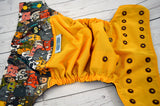 My Favorite Animal ( marigold outer, two-toned snaps- marigold caps / brown pieces)<br>Wrap Around, One Size Pocket Diaper<br>Instock and Ready to Ship