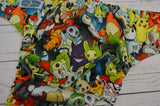 Poke Characters (citron awj, red caps, marigold pieces)<br>Traditional, One Size Pocket Diaper<br>Instock and Ready to Ship