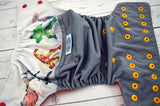 It's Thorsday ( grey outer, two-toned snaps- red caps / marigold pieces)<br>Wrap Around, One Size Pocket Diaper<br>Instock and Ready to Ship