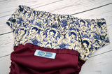 Not so Traditional Tattoo (burgundy outer, navy snaps)<br>Wrap Around, One Size Pocket Diaper<br>Instock and Ready to Ship