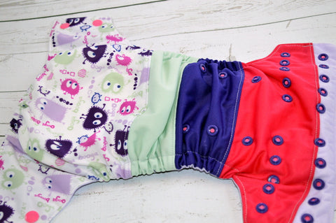 Booga Boogie ( two-toned snaps - hot pink caps / imperial pieces)<br>Bella Bum Scrappy, One Size Pocket Diaper<br>Instock and Ready to Ship