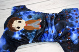 Who's in Space? (blue galaxy outer, two-toned snaps - royal caps / brown pieces)<br>Embroidered, One Size Pocket Diaper<br>Instock and Ready to Ship