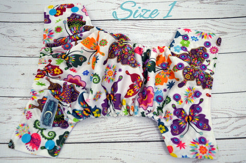 Newborn Violet Kaleidoscope Butterflies (lavender inner, two toned violet and aqua snaps) <br>Traditional Size One Pocket Diaper<br>Instock and Ready to Ship