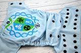 Plutonium Crest (light blue outer, black snaps)<br>Embroidered, One Size Pocket Diaper<br>Instock and Ready to Ship