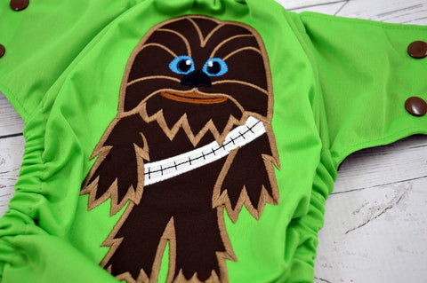 Chewy (spring green outer, brown snaps)<br>Embroidered, One Size Pocket Diaper<br>Instock and Ready to Ship
