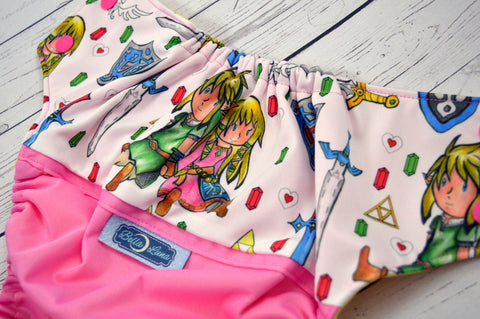 Hyrule Pink Picnic (raspberry outer, two-toned snaps - hot pink caps / marigold pieces)<br>Wrap Around, One Size Pocket Diaper<br>Instock and Ready to Ship