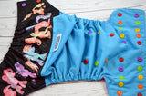 Paint Splatter Pony (aqua outer,  red/orange/marigold/apple/violet alternating snaps)<br>Wrap Around, One Size Pocket Diaper<br>Instock and Ready to Ship
