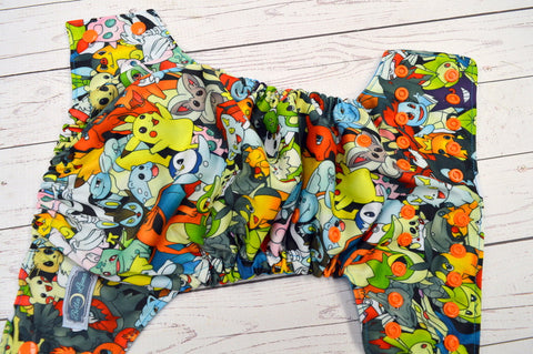 Poke Characters (Aqua awj, Snaps; Orange) <br>Traditional, One Size Pocket Diaper<br>Instock and Ready to Ship