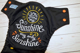 My Sunshine (black pul, orange awj, orange caps, marigold pieces) <br>Embroidered, One Size Pocket Diaper<br>Instock and Ready to Ship